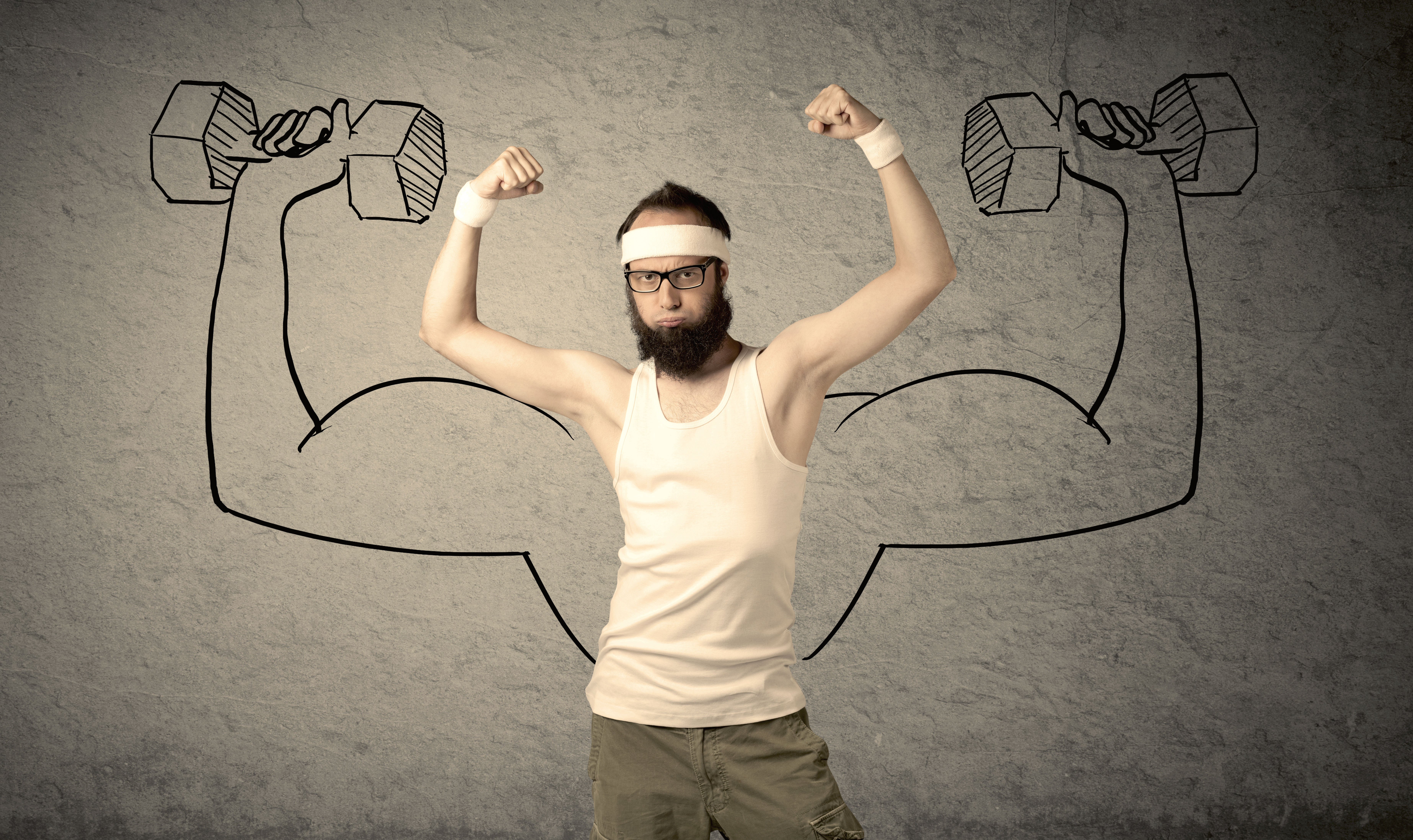 A young college student with beard and glasses posing in front of grey background, thinking about lifting weight with big muscles, illustrated by white drawing concept.