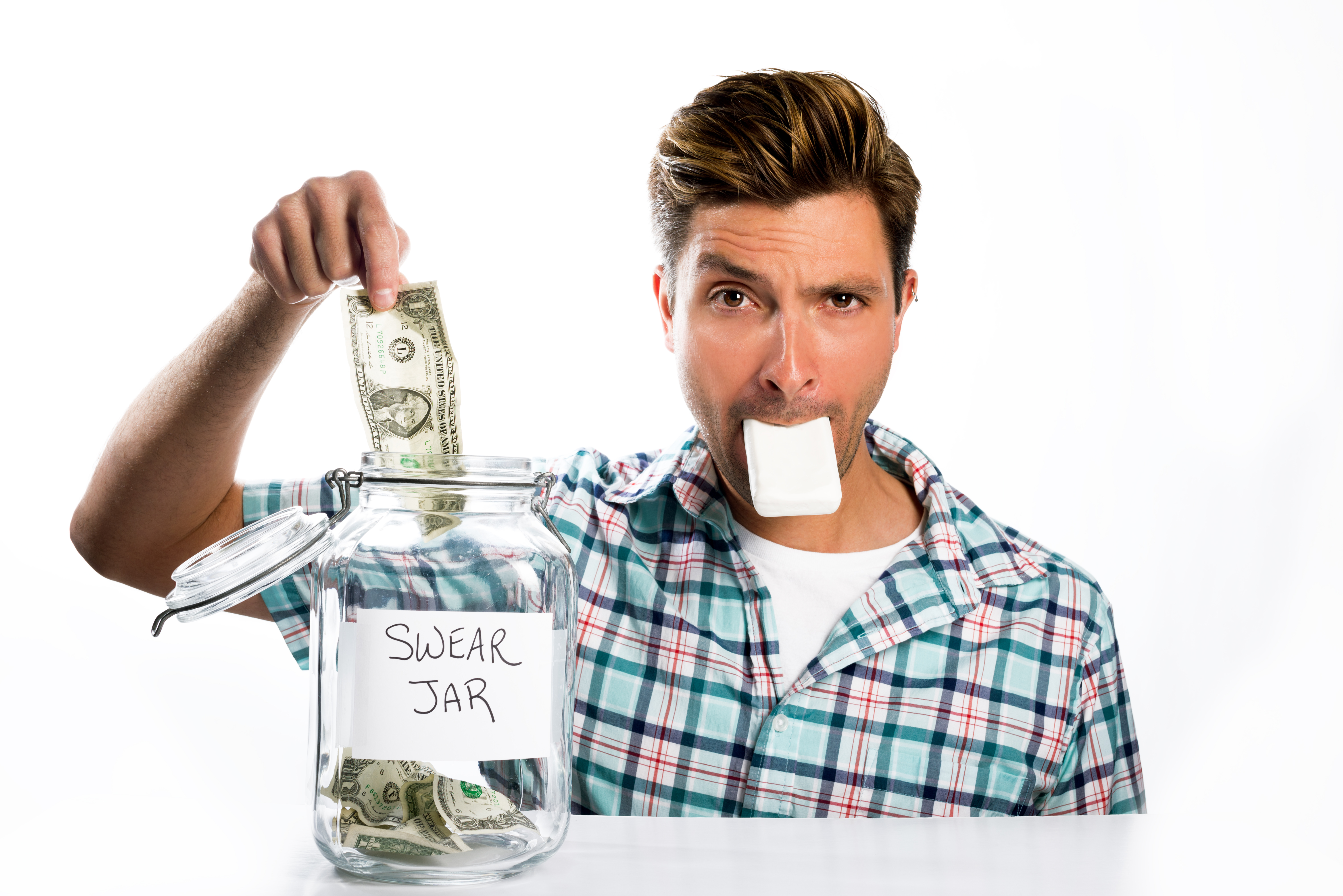 A man paying into a swear jar with a bar of soap in his mouth.